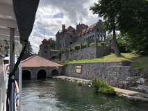 Boathouse with castle in the background